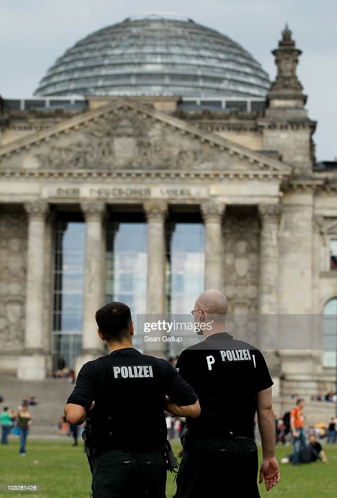 Police walk in front of the Reichstag while observing the nearby annual Hemp Parade, or 'Hanfparade', which is a march in support of the legalization of marijuana in Germany, on August 7, 2010 in Berlin, Germany. The consumption of cannabis in Germany is legal, though all other aspects, including growing, importing and selling it, are not. However, since the introduction of a new law in 2009, the sale and possession of marijuana for licenced medicinal use is legal.