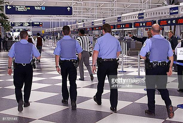 Police walk the United Airlines terminal at O'Hare International Airport 13 September after the airport reopened after being closed for two days...