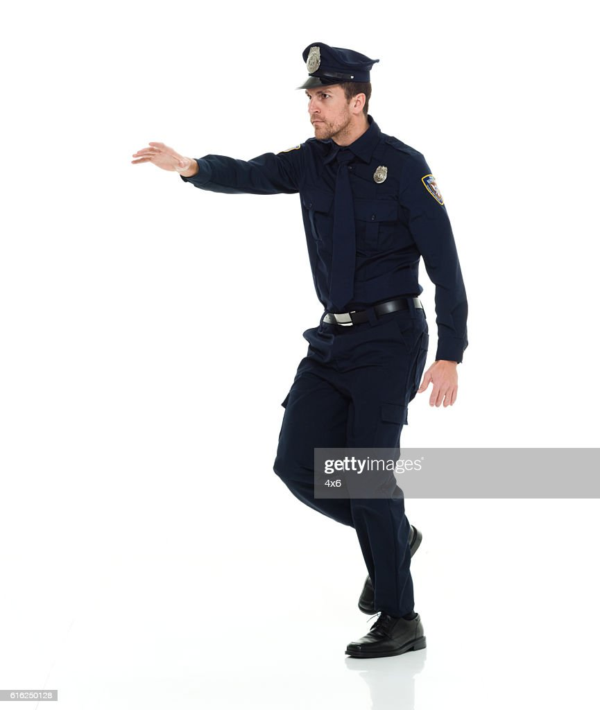 Police walking and gesturing : Stock Photo
