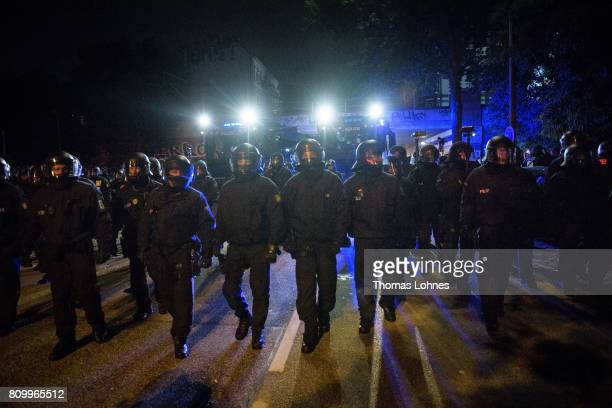 Police walking to demonstrators near the Rote Flora leftwing centre after the 'Welcome to Hell' protest march on July 6 2017 in Hamburg Germany...