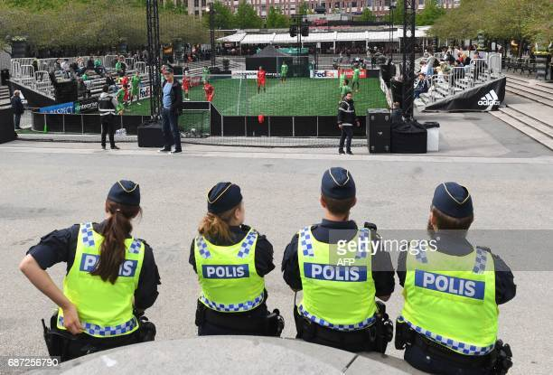 Police watch a football match outside the Friends arena in Stockholm on May 23 on the eve of the UEFA Europa League football final between Ajax...