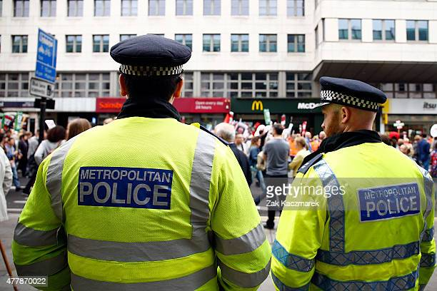 Police watch an Anti Austerity demonstration at Bank Of England on June 20 2015 in London England Thousands of people gathered to march from the City...