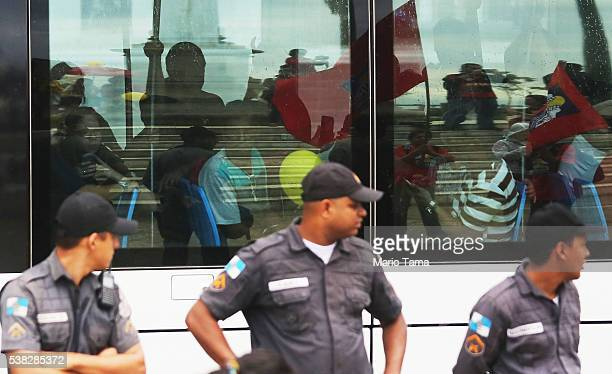 Police watch as a new VLT passes as antiTemer protesters are reflected in the window on the day the VLT system was inaugurated ahead of the upcoming...