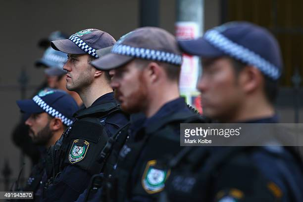 Police watch on as they separate protestors in Marden street outside Parramatta Mosque on October 9 2015 in Sydney Australia Protesters gathered at...