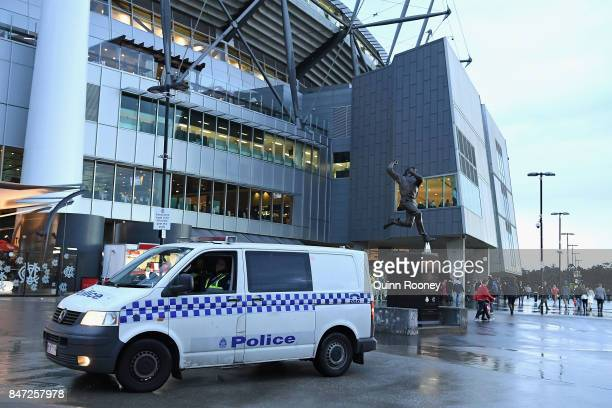 Police watch on outside the MCG during the Second Semi Final AFL match between the Geelong Cats and the Sydney Swans at Melbourne Cricket Ground on...