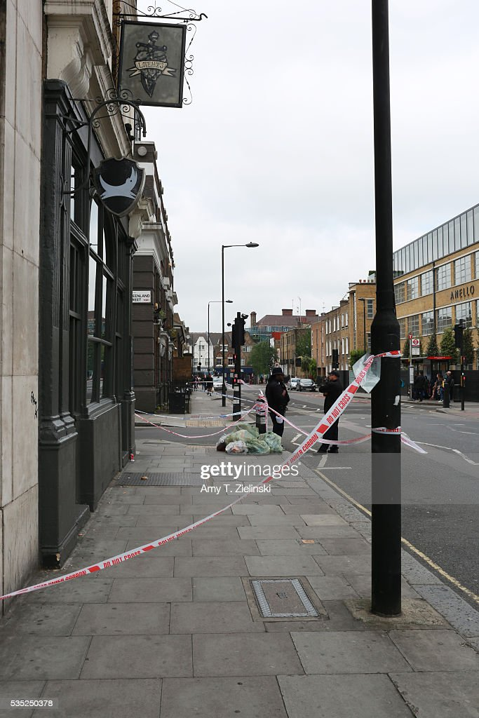 Police watch over a cordoned off section of Bayham street as a murder investigation is underway in Camden on May 29, 2016 in London, England. Reportedly a stabbing took place in the area leaving one man dead after being taken to the hospital.