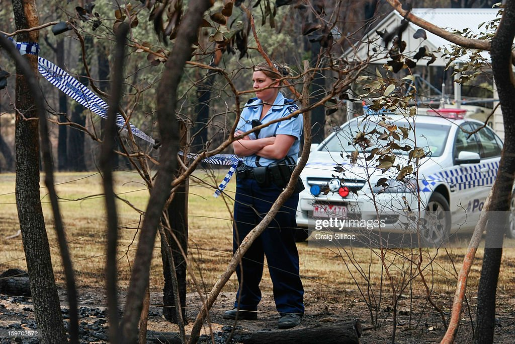 Police watch over a house where a man was found dead in his car in the town of Seaton on January 19, 2013 in Melbourne, Australia. Bushfires in Victoria have claimed one life and destroyed several houses. Record heat continues to create extreme fire conditions throughout Australia.