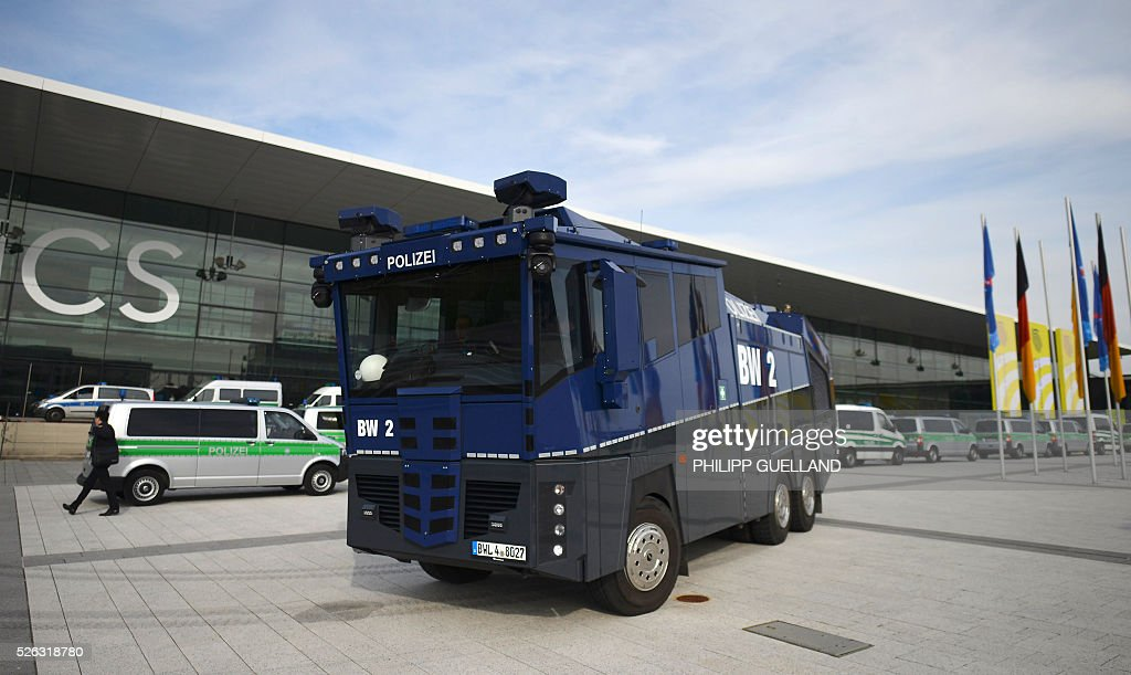 A police water cannon stands in front of the Stuttgart Congress Centre ICS where a party congress of the German right wing party AfD (Alternative fuer Deutschland) takes place on April 30, 2016 in Stuttgart, southern Germany. Protesters tried to block the access to the party conference of the 'Alternative Fuer Deutschland' (Alternative for Germany) with around 400 being taken into custody. / AFP / Philipp GUELLAND