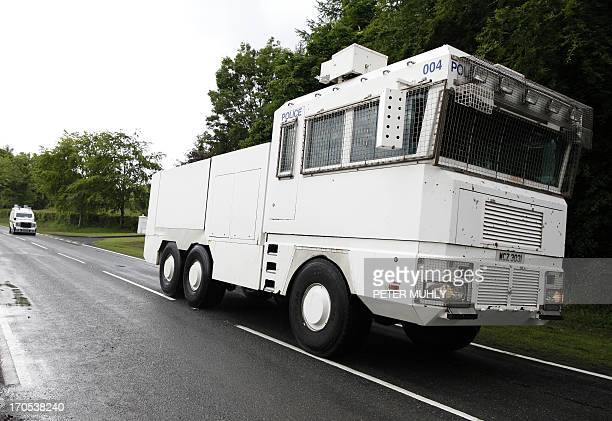 A police water cannon vehicle travels towards the Lough Erne Golf Resort in Enniskillen Northern Ireland on June 14 in preparation for the G8 Summit...