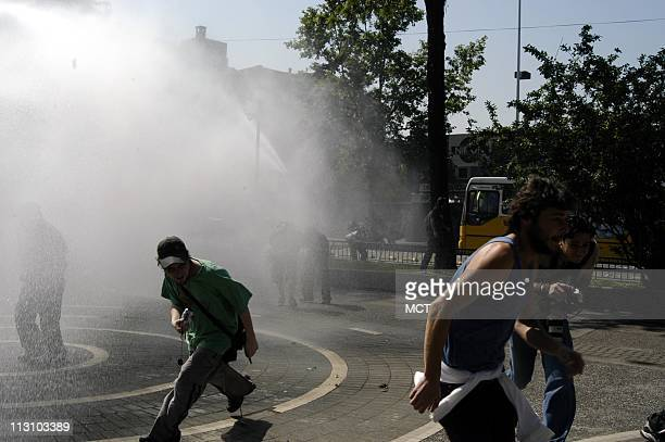 SANTIAGO CHILE Police water cannons laced with a irritant ike mace or tear gas go into action during an unauthorized demonstration of some 100150...
