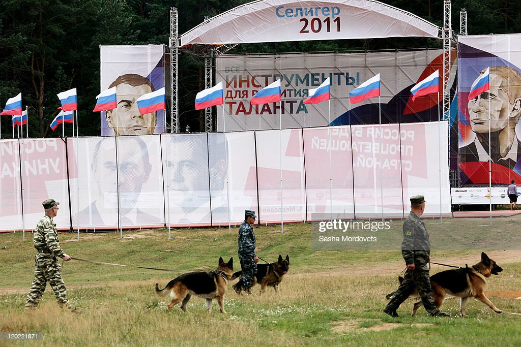 Police with dogs patrol the grounds of the Seliger educational youth forum August 1, 2011 at Lake Seliger, Tver Region, Russia, on August, 1, 2011. Putin commented on the unification of Russia and Belarus stating that it fully depends 'on the will of the Belarusian people.'