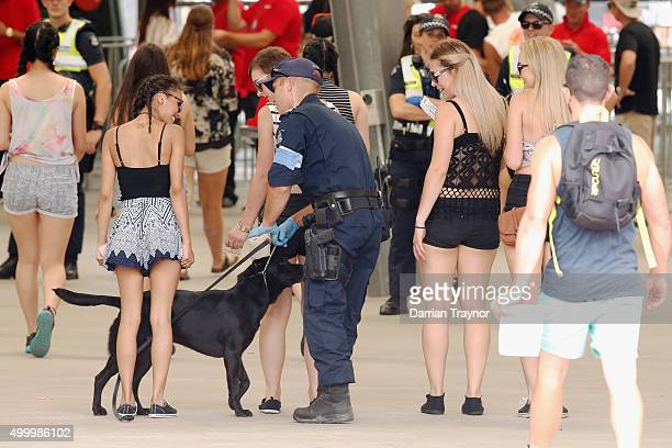 Police with sniffer dogs search patrons before entry into the Sterio Sonic music festival at Melbourne Showgrounds on December 5 2015 in Melbourne...