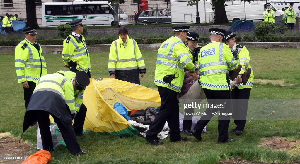 Police with the peace campers after letters were issued to the campers asking them to leave Parliament Square after claims that they have 'overstepped the mark'.