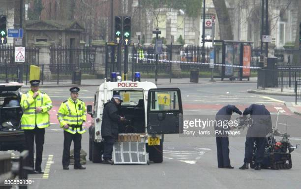 Police with their radiocontrolled robot after carrying out a controlled explosion on a suspect car in Victoria London as police are on high alert...