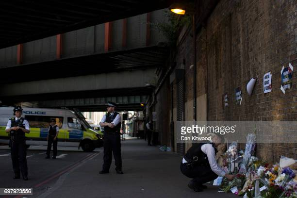A police woman lays flowers ahead of a vigil outside Finsbury Park Mosque on June 19 2017 in London England Worshippers were struck by a hired van as...