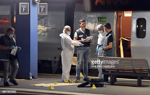 Police work on a platform next to a Thalys train of French national railway operator SNCF at the main train station in Arras northern France on...