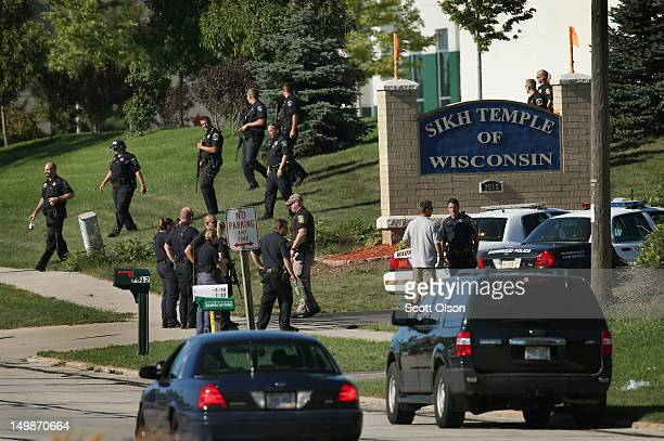 Police work outside the Sikh Temple of Wisconsin where at least one gunman stormed the mass and opened fire August 2012 Oak Creek Wisconsin At least...