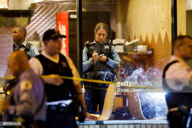Police work the scene where three people were shot on Saturday Oct 21 2017 at a Taco Burrito King Restaurant in Chicago Ill