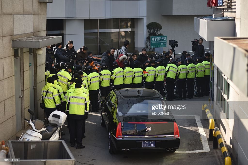 Police yellow0 stand guard as journalists gather outside the Gangbuk Samsung hospital where US ambassador to South Korea Mark Lippert was taken...
