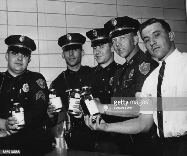 Policeman Aid Girl with Rejoined Arm The Policemen are from left Sgt WE Kerls Patrolmen Dennis Peterson Elmer Lindner and Gerald Van deVenter and...