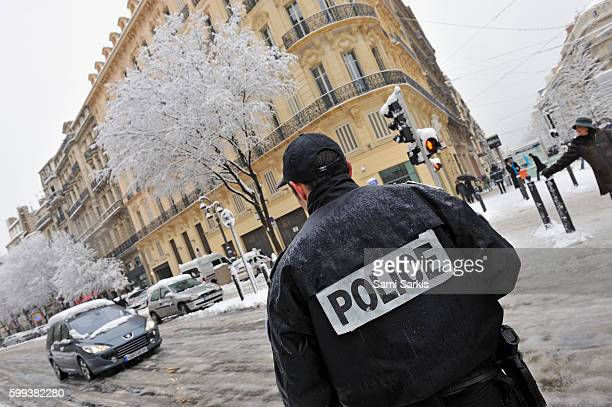 Policeman and cars after heavy snow in Marseille, France, Europe