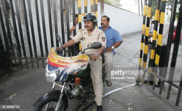 Policeman at Advocate Kikhushw Lam resident at New Brech Candy Apartmentt after he aproach for Amir Ajmal Kasab Case in Mumbai on Wednesday