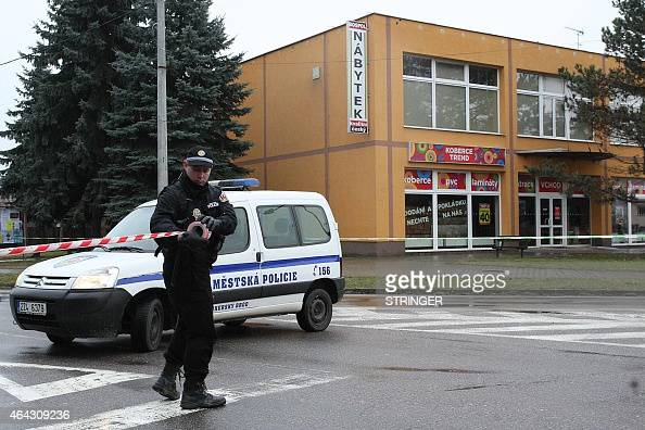 A policeman blocks a street of Uhersky Brod Czech Republic on February 24 2015 after an apparently unstable armed man bursted into a restaurant in...