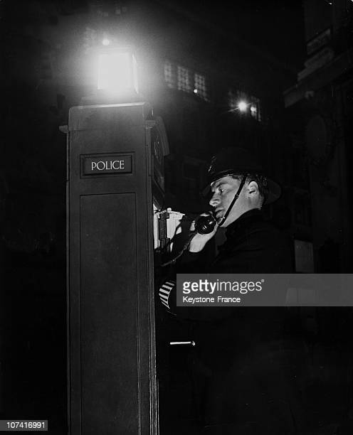 Policeman Calling Up The Station In London