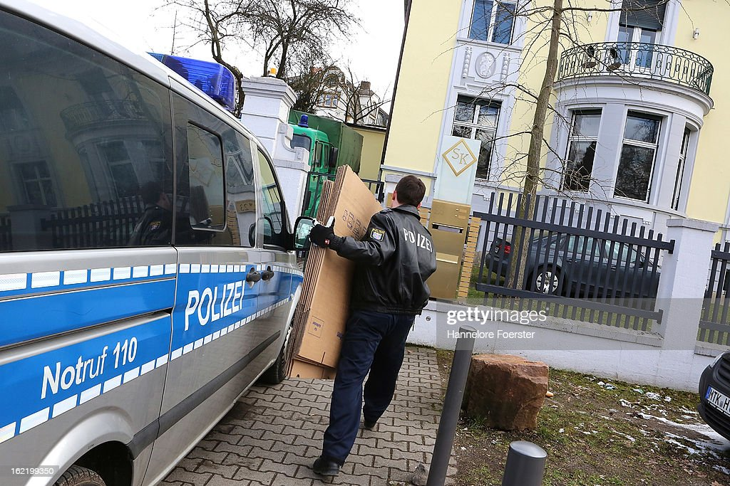 A policeman carries boxes out of the headquarters of the S&K investment group the day after police raided the company's offices on February 20, 2013 in Frankfurt, Germany. Police made six arrests across Germany and state prosecutors are charging that the company has swindled investors out of investments totaling over one hundred million Euros. At least one of the company's founders, Jonas Koeller and Stephan Schaefer, was among those arrested yesterday.