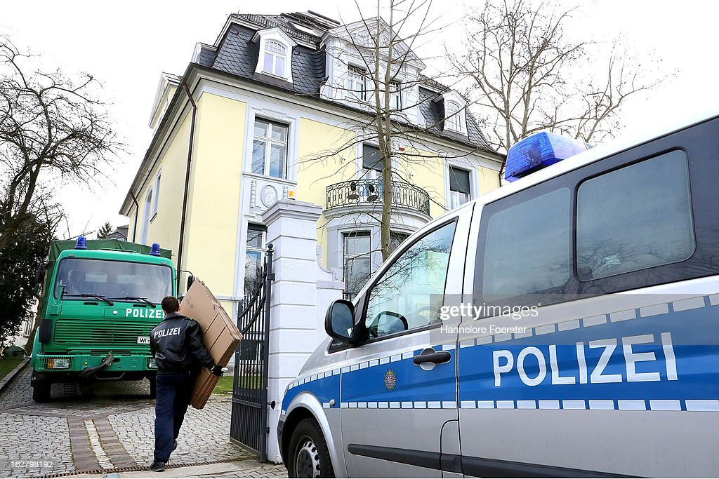 A policeman carries boxes to the headquarters of the S&K investment group the day after police raided the company's offices on February 20, 2013 in Frankfurt, Germany. Police made six arrests across Germany and state prosecutors are charging that the company has swindled investors out of investments totaling over EUR 100 million. The company was founded by Jonas Koeller and Stephan Schaefer, and at least one of them is under those arrested yesterday.