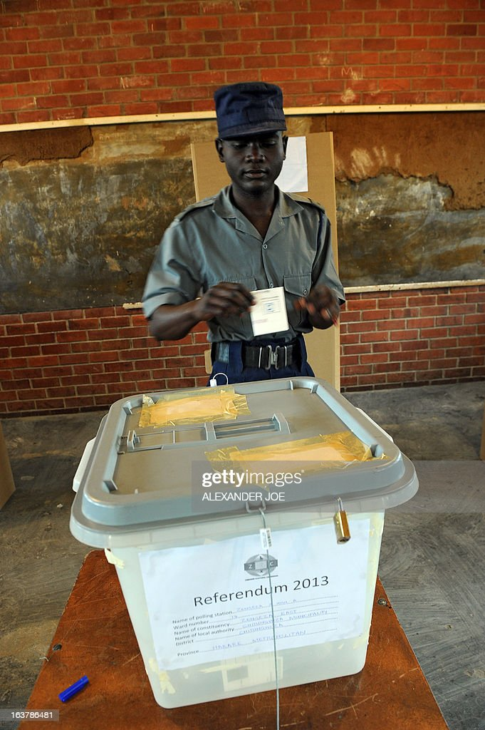 A policeman cast his vote at a polling station in Chitungwiza, on March 16, 2013, as voting kicked off for Zimbabwean referendum for a new constitution designed to underpin democratic reforms. AFP PHOTO / ALEXANDER JOE