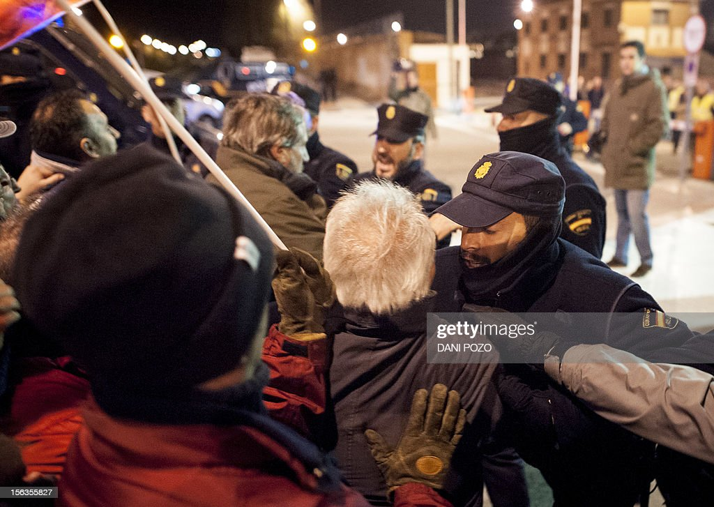 Policeman clash with picketing strikers who try to prevent the departure of buses on the parking lot of the Madrid Bus Company during a general strike on November 14, 2012 in Madrid. General strikes in Spain and Portugal will spearhead the day of action called by European unions and joined by activists as anger over governments' tight-fisted policies boils over.
