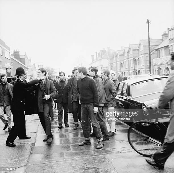 A policeman clashes with a mod in Clacton at a time when teenagers were rioting in the area 30th March 1964