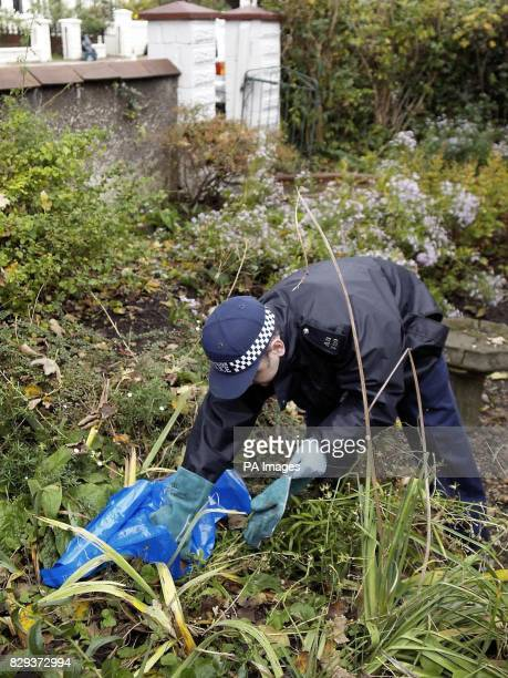 A policeman continues to search the nearby area in Airedale Avenue Chiswick west London where a middleaged man is believed to have been stabbed to...