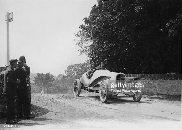 A policeman covers his ears and looks on as Joseph Rutsch drives the Adler III over Ballaugh Bridge during the Royal Automobile Club Isle of Man...