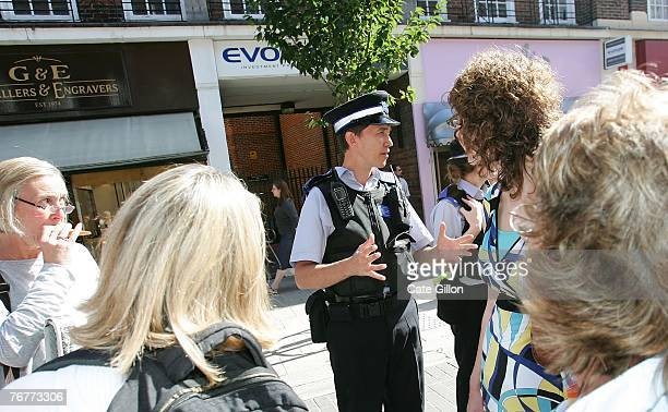 A policeman deals with customers of Northern Rock as they queue outside the Kingston branch of the company on Castle Street in order to take their...