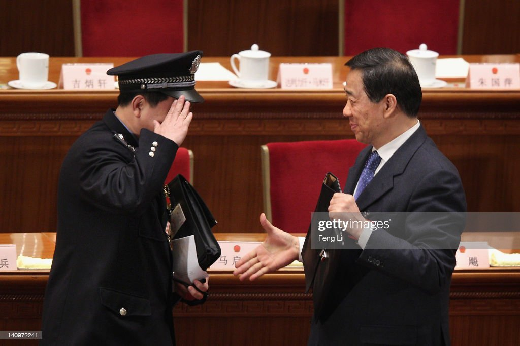 A policeman delegate salute to China's Chongqing Municipality Communist Party Secretary <a gi-track='captionPersonalityLinkClicked' href=/galleries/search?phrase=Bo+Xilai&family=editorial&specificpeople=225006 ng-click='$event.stopPropagation()'>Bo Xilai</a> (Right) after the third plenary meeting of the National People's Congress (NPC) at The Great Hall Of The People on March 9, 2012 in Beijing, China. China's Chongqing Municipality Communist Party Secretary <a gi-track='captionPersonalityLinkClicked' href=/galleries/search?phrase=Bo+Xilai&family=editorial&specificpeople=225006 ng-click='$event.stopPropagation()'>Bo Xilai</a> said he was surprised to learn that his ex-police chief had run off to a US consulate during the the National People's Congress Chongqing group meeting today.