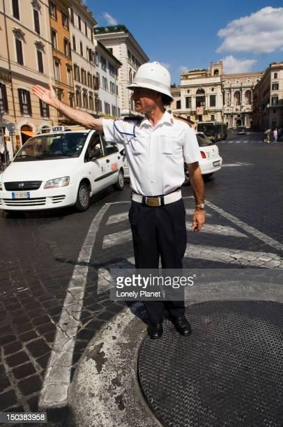 Policeman directing traffic, Centro Storico.