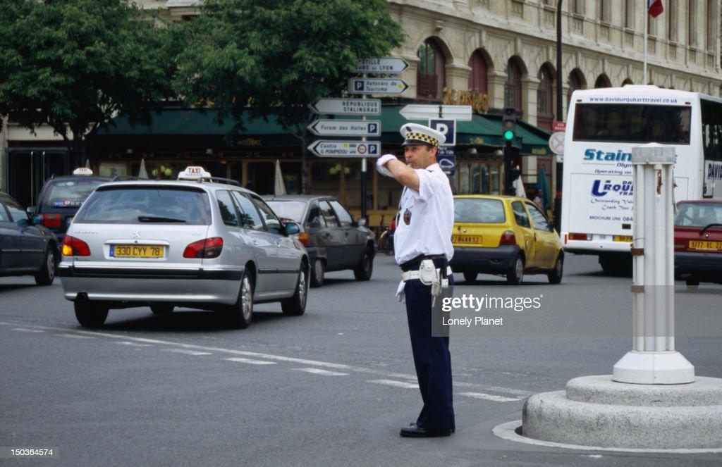 Policeman directing traffic near Notre Dame.