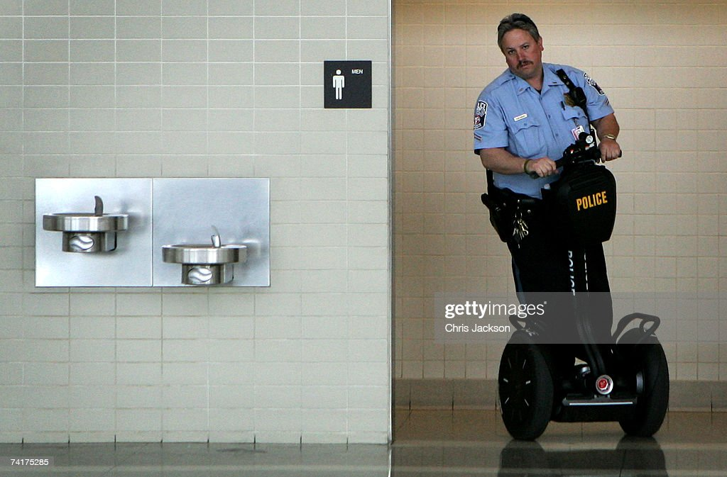 A policeman drives out of a restroom on a Segway Human Trasporter at Dulles Airport on May 7, 2007 in Dulles, Virginia.