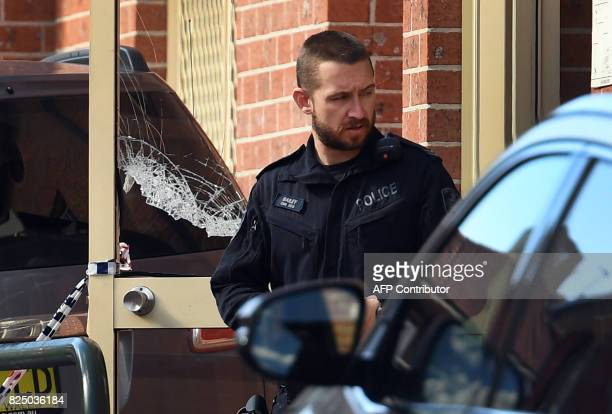 A policeman emerges from a block of flats in the Sydney suburb of Lakemba on August 1 after counterterrorism raids across the city at the weekend...