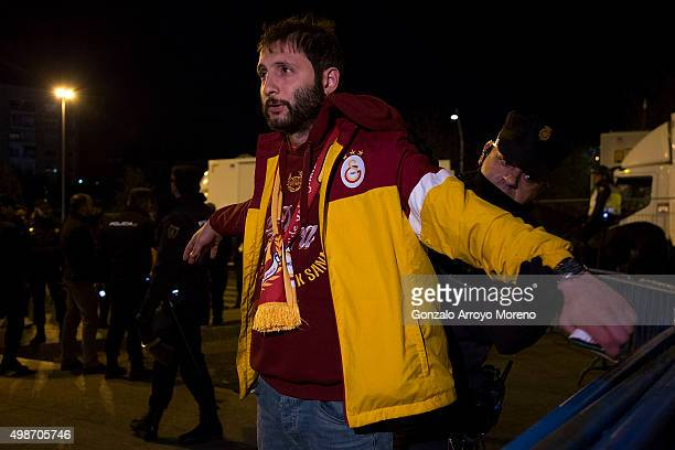 A policeman frisks a Galatasaray fan at Estadio Vicente Calderon before the UEFA Champions League Group C match between Club Atletico de Madrid and...