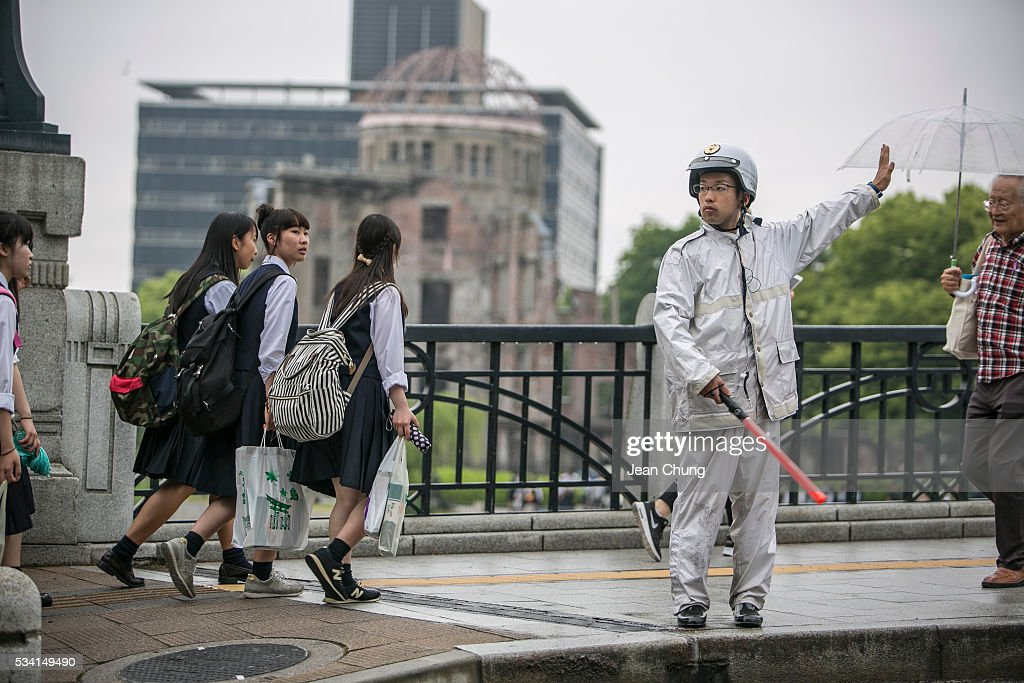 A policeman from Nagasaki (R) controls traffic in front of the A-Bomb dome inside Peace Memorial Park on May 26, 2016 in Hiroshima, Japan. On May 27, 2016, the U.S. President Obama is scheduled to visit Hiroshima, which will be the first time a U.S. President makes an official visit to the iconic site where the atomic bomb was dropped in the end of World War II.