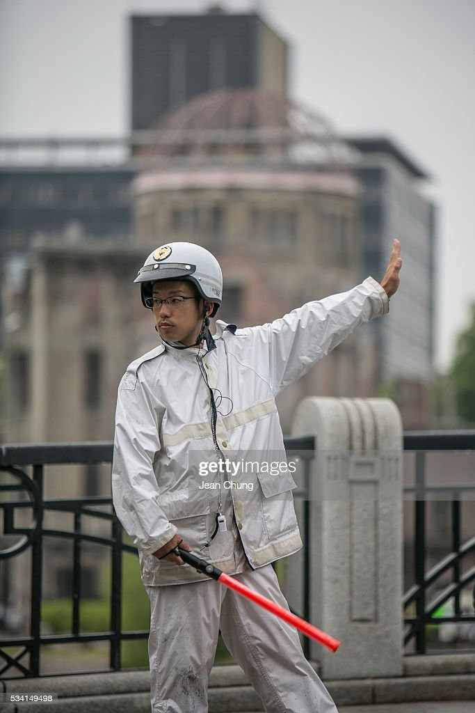 A policeman from Nagasaki controls traffic in front of the A-Bomb dome inside Peace Memorial Park on May 26, 2016 in Hiroshima, Japan. On May 27, 2016, the U.S. President Obama is scheduled to visit Hiroshima, which will be the first time a U.S. President makes an official visit to the iconic site where the atomic bomb was dropped in the end of World War II.