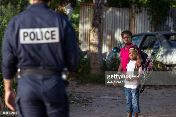 A policeman from the anticrime unit patrol in Cayenne's Mango neighborhood on March 7 2013 during a three days visit by France's Interior minister in...