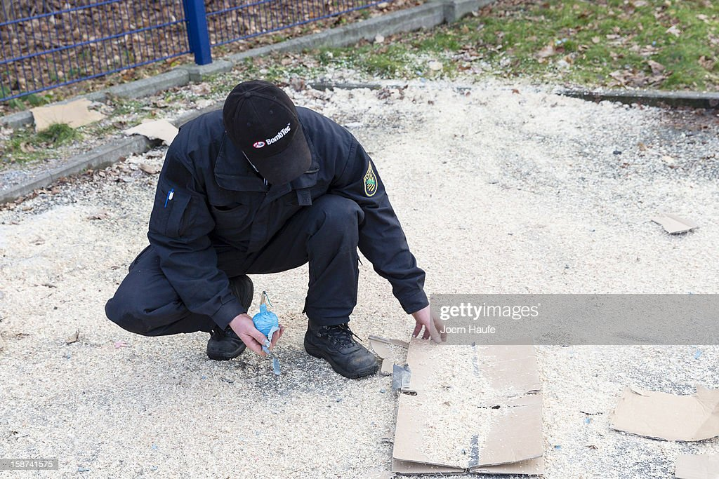 A Policeman from the Saxony state police examines an exploded box during a presentation of illegal fireworks to the media on December 27, 2012 in Dresden, Germany. The legalized sale of fireworks to welcome in the New Year begins nationwide in Germany on December 28 and police are warning of the danger of certain types of fireworks imported illegally from countries like Poland and the Czech Republic.