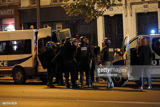 Policeman gather near the Boulevard des FillesduCalvaire after an attack November 13 2015 in Paris France Gunfire and explosions in multiple...