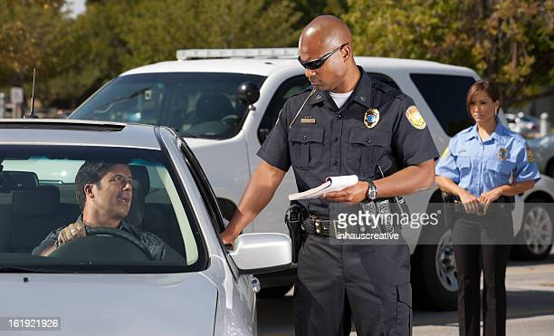 Policeman giving a traffic ticket