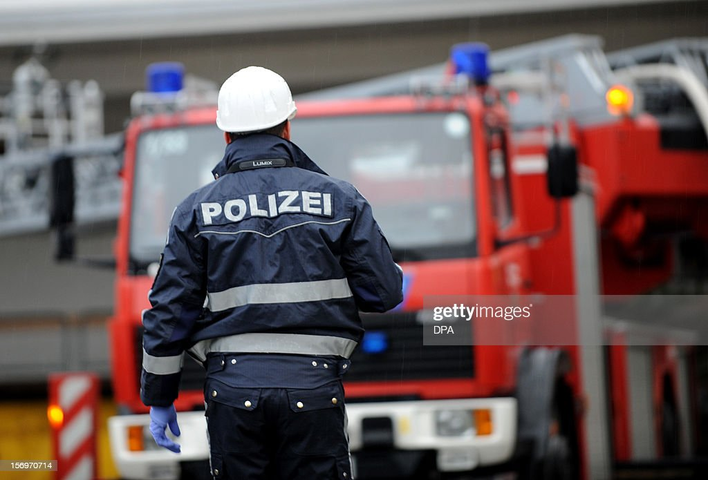 A policeman goes to house with a workshop for handicapped people in Titisee- Neustadt, southern Germany on November 26, 2012. Fourteen people died after a fire in the house broke out. AFP PHOTO / PATRICK SEEGER GERMANY OUT