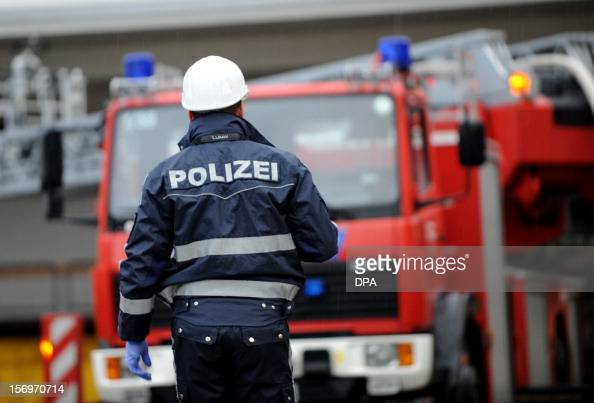 A policeman goes to house with a workshop for handicapped people in Titisee Neustadt southern Germany on November 26 2012 Fourteen people died after...